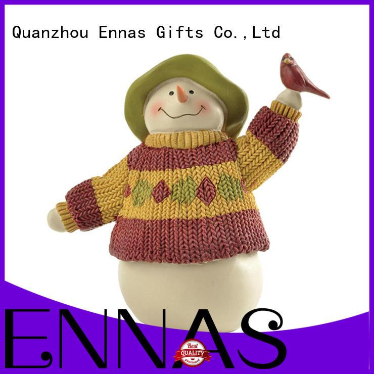 Holding a Red Bird Snowman Figurine